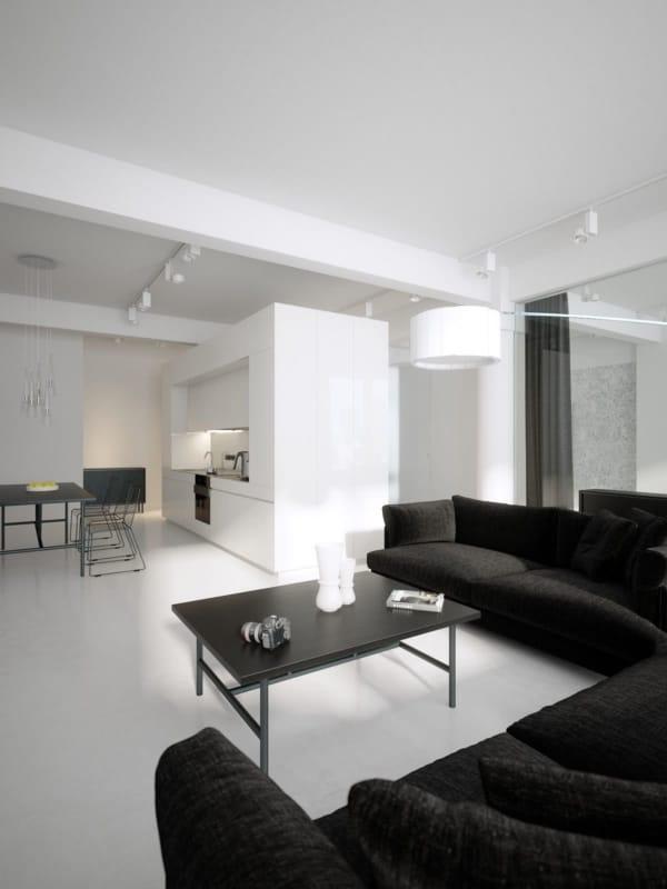 Paredes brancas e sofá preto