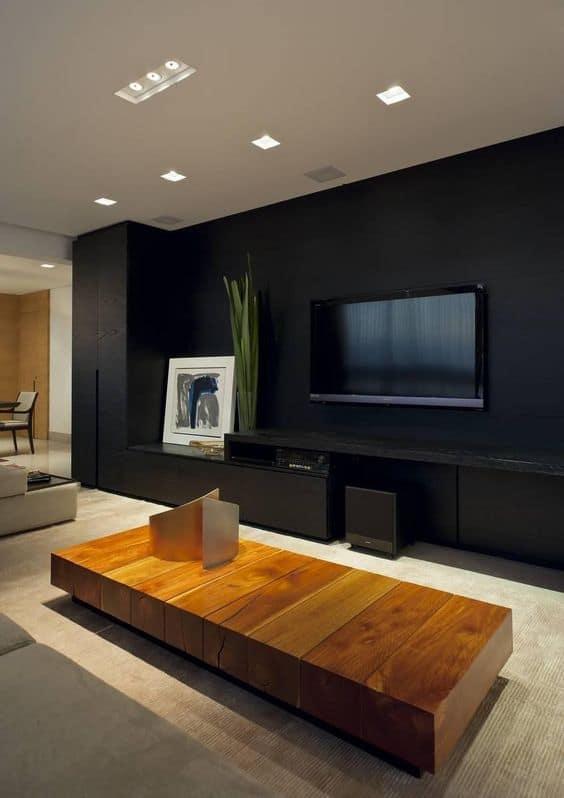 sala de TV com parede preta