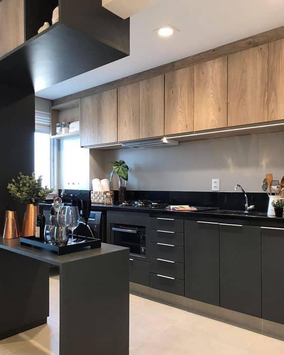 cozinha planejada com armários pretos