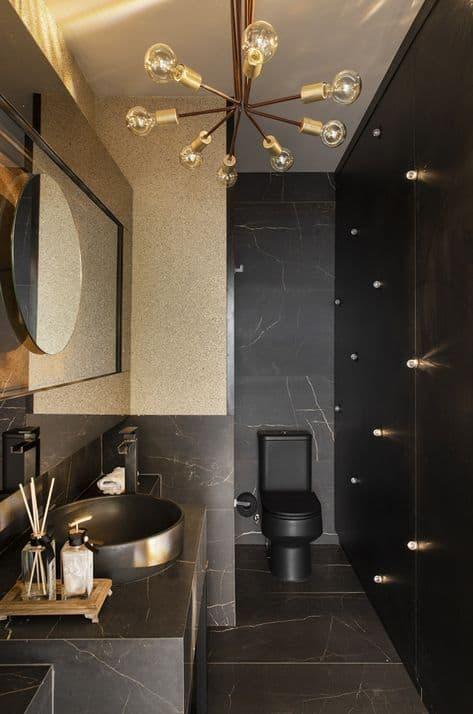 lavabo moderno em preto e dourado