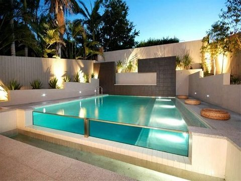 Ideia de piscina moderna de vidro com luzes