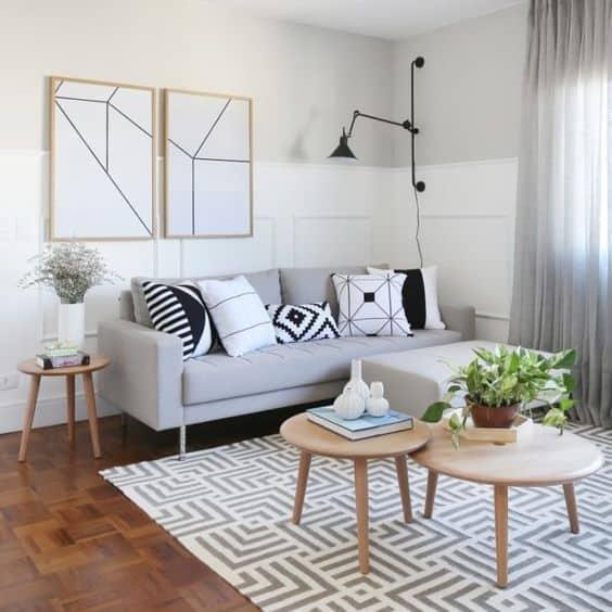 sala tumblr neutra com quadros geométricos preto e branco