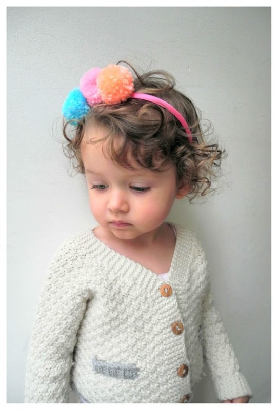 tiara de criança com pompons de lã