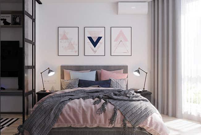 quarto com quadros geométricos na parede
