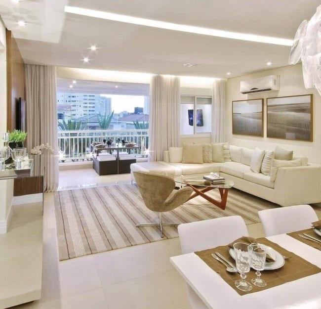 sala moderna e clean com parede cor creme