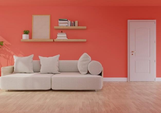 Cor coral na sala com decoração clean