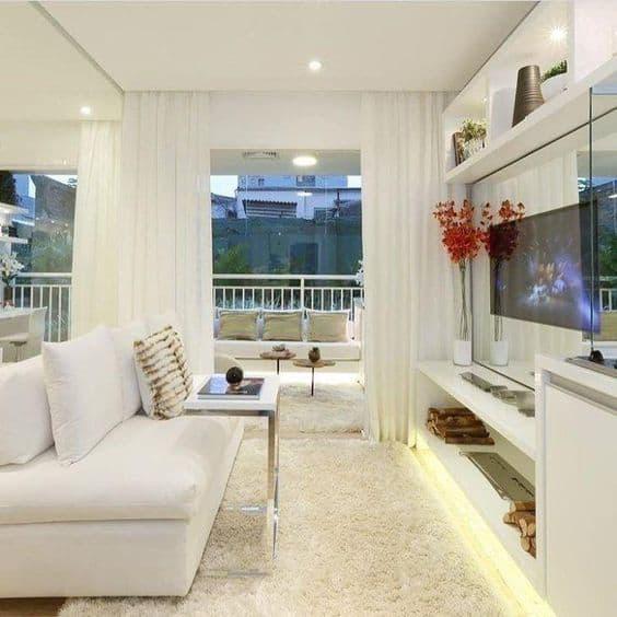 decoração de sala de apartamento com cor branca