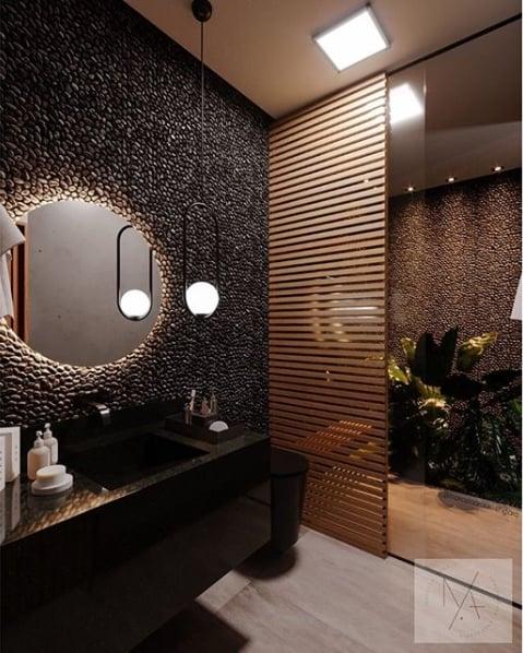 banheiro moderna com bancada e cuba esculpida em granito preto absoluto
