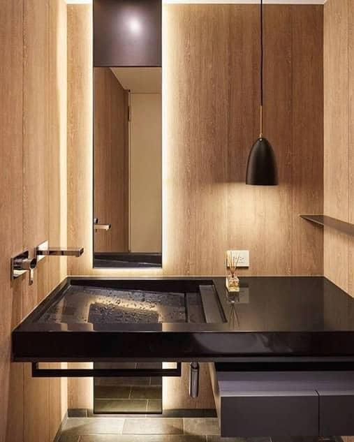 lavabo moderno com bancada esculpida de granito preto absoluto