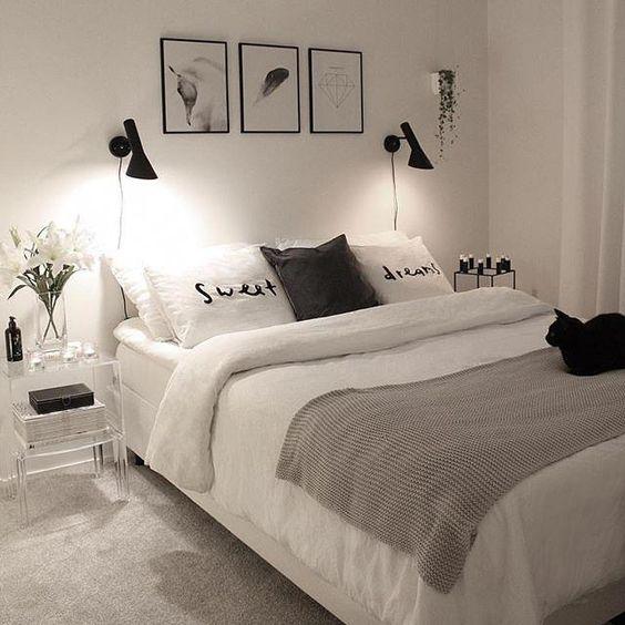 quarto com cor branca e detalhes em preto e cinza