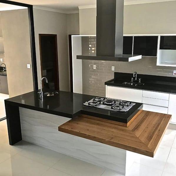 cozinha de ilha em granito preto absoluto