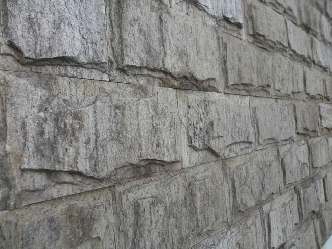 Pedra madeira verde em parede