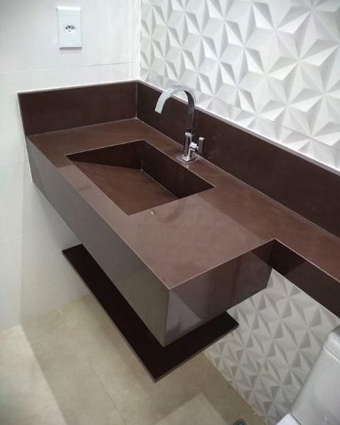bancada de banheiro com cuba esculpida em granito marrom absoluto
