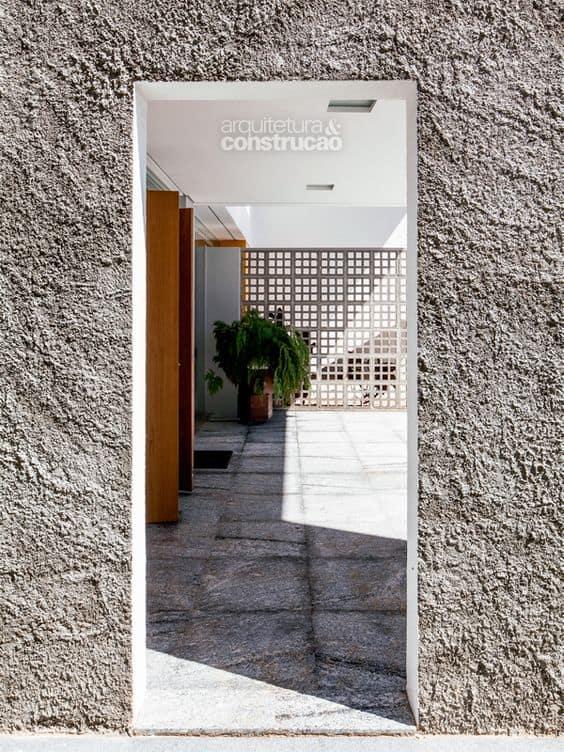 fachada de muro com chapisco de cimento
