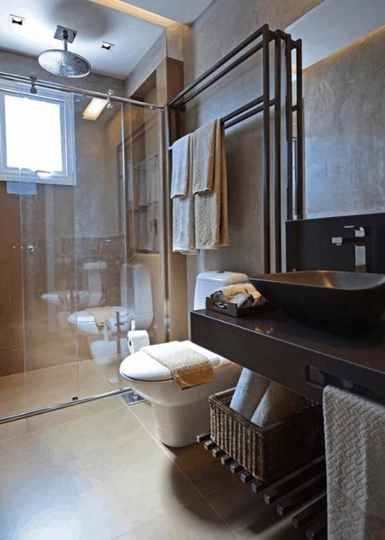 banheiro moderno com bancada de granito marrom
