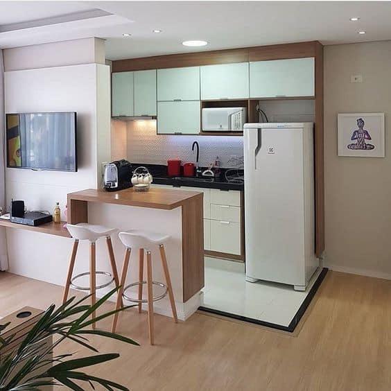 cozinha americana com armarios planejados em verde menta