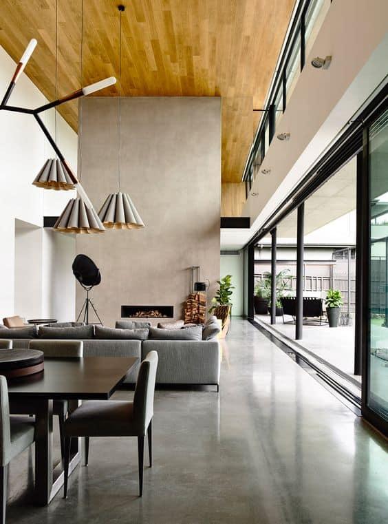 sala estilo industrial com piso de concreto polido