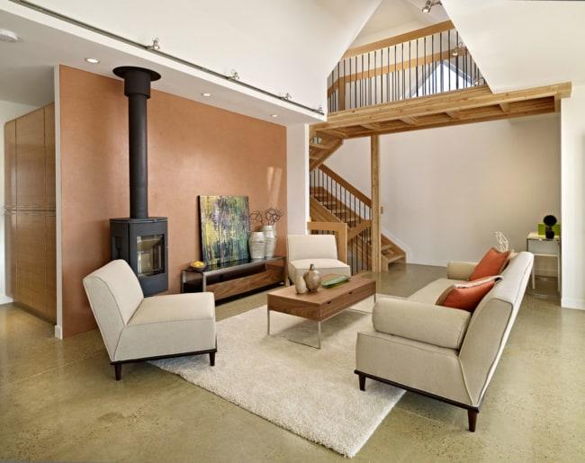 sala com lareira e piso de concreto polido