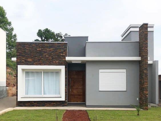 casa terrea com fachada cinza e pedras
