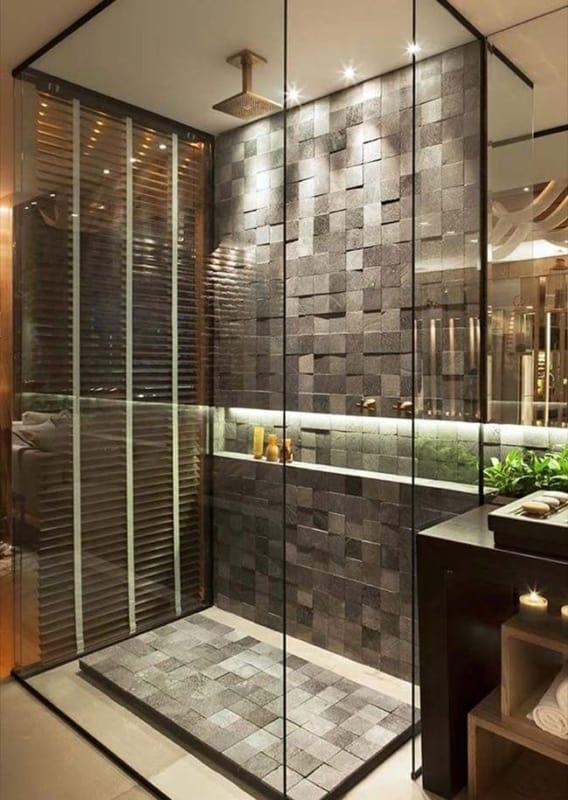banheiro moderno com piso de pedras decorativas