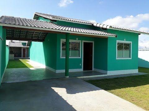 fachada de casa terrea com telhado embutido e garagem coberta