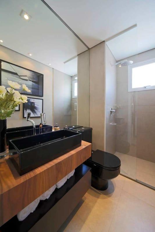 banheiro com porcelanato cimento queimado e louca preta