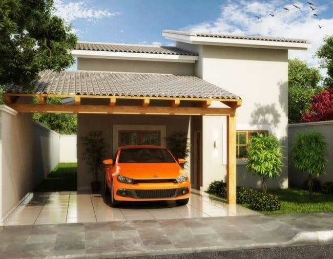 projeto de casa pequena com telhado aparente e garagem na frente
