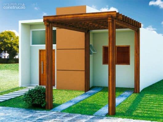 projeto de casa moderna pequena com garagem de pergolado