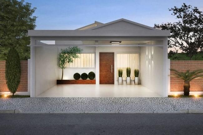 projeto de casa terra moderna com garagem na frente