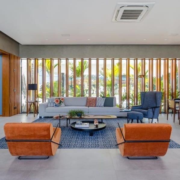 sala de estar moderna com piso que imita cimento