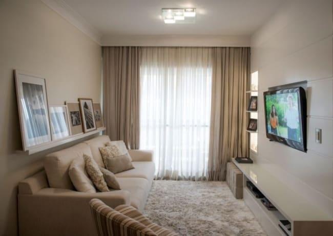 sala de apartamento com parede cor areia