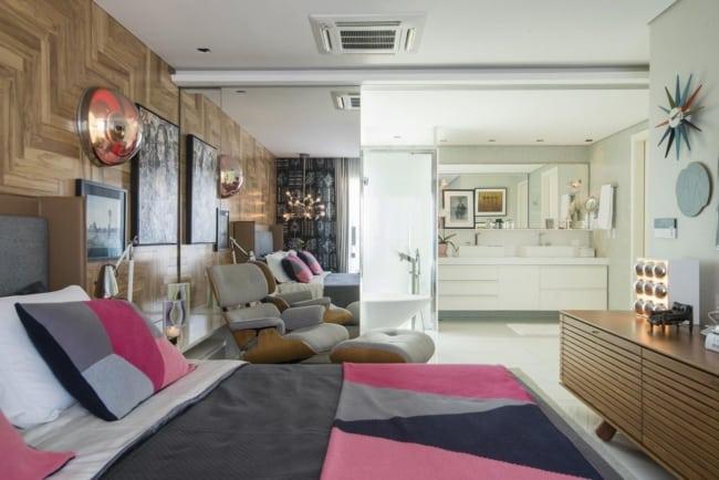 quarto decorado com poltrona poltrona Charles Eames cinza