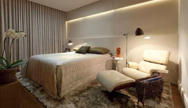quarto de casal com poltrona Charles Eames branca
