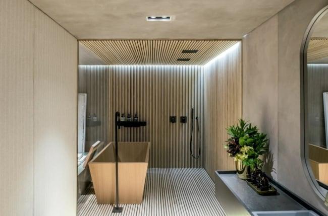 banheiro moderno com banheira em cor areia