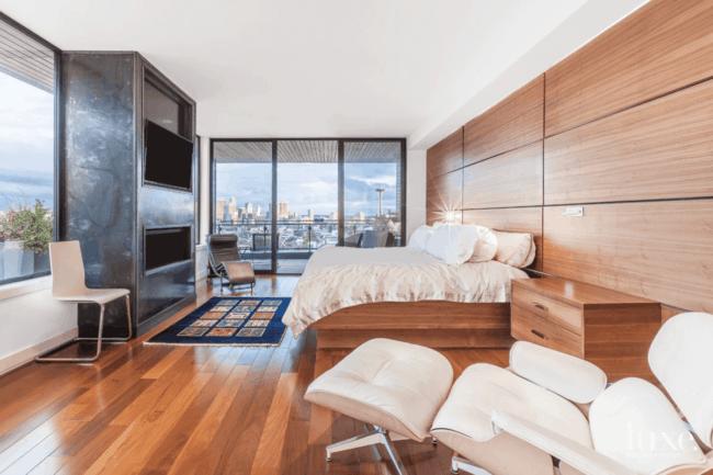 quarto de casal grande com poltrona Charles Eames