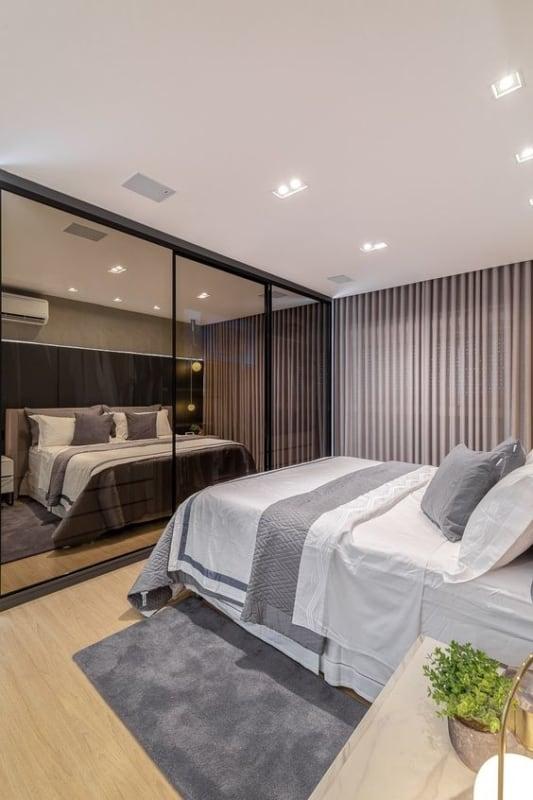 quarto de casal moderno com detalhes em cinza claro