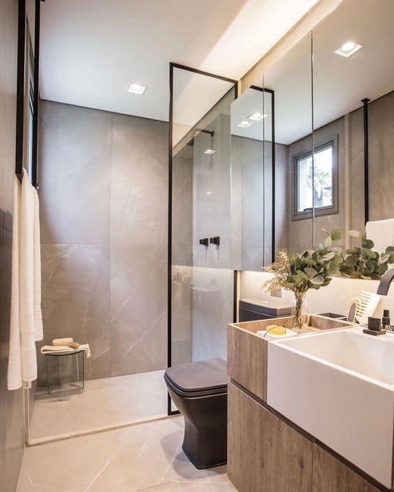 banheiro pequeno e moderno em cinza claro