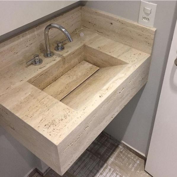 bancada de banheiro com cuba esculpida em travertino romano