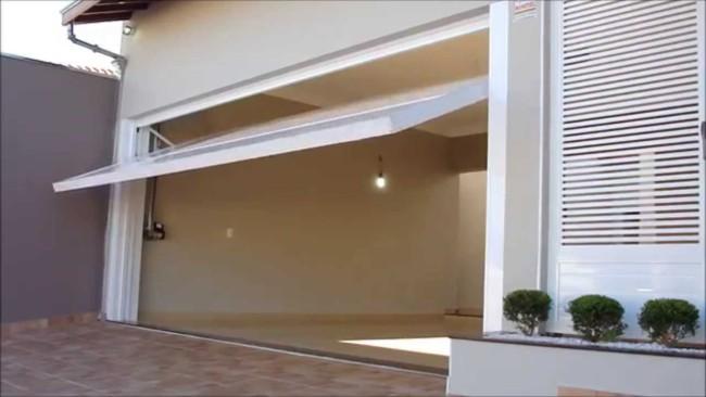 casa com portao eletrico basculante
