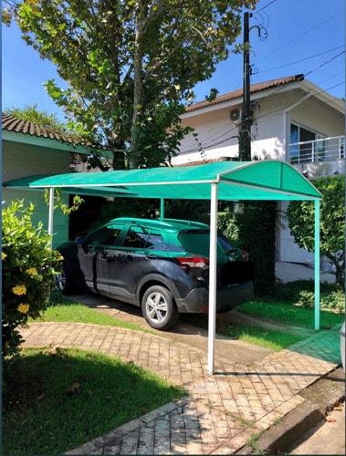 casa com toldo simples e fixo para garagem