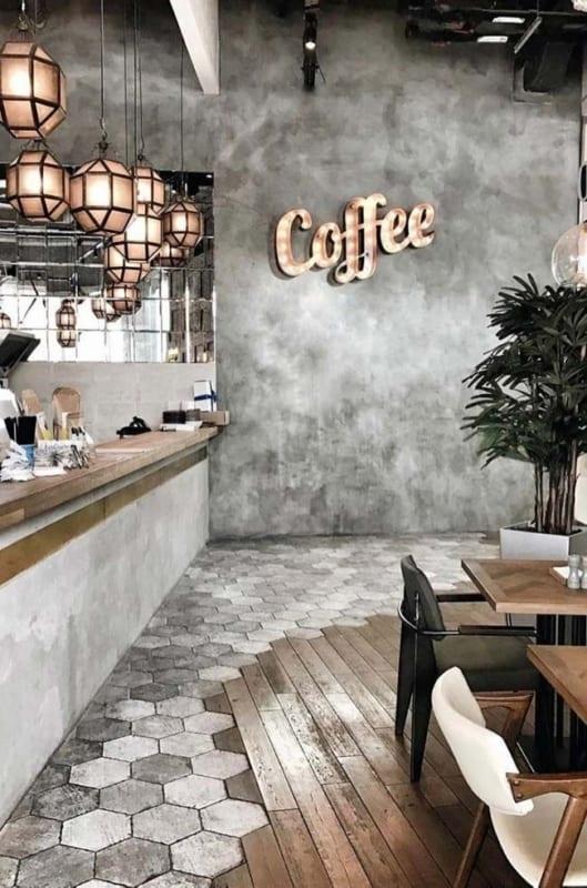 cafeteria gourmet com parede de cimento queimado