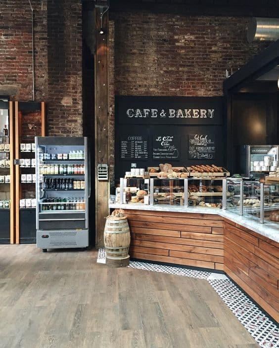cafeteria rustica com parede de tijolos aparentes