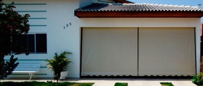 9 fachada de casa com toldo cortina na garagem