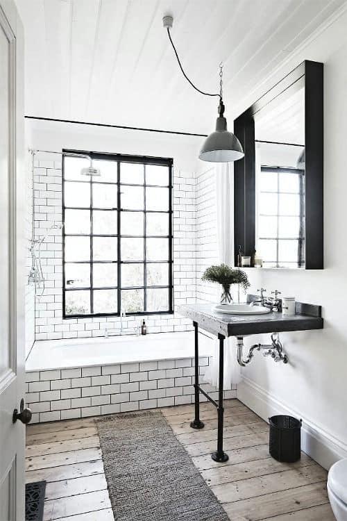 banheiro com decoracao industrial e rustica