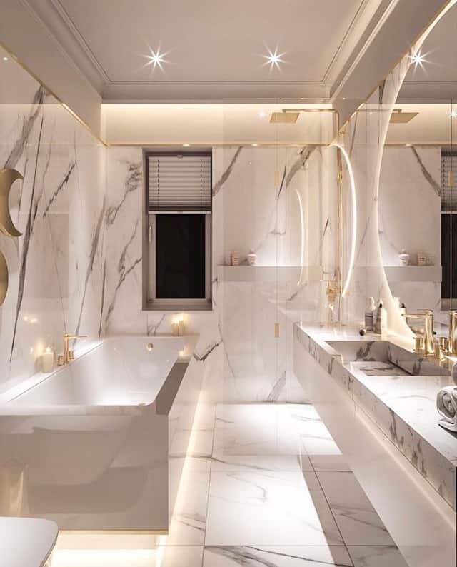 banheiro elegante com decoracao em mamore e detalhes dourados