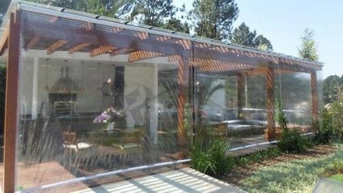 toldo cortina transparente em varanda gourmet